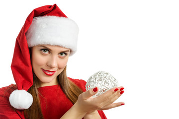 woman in red winter hat holding decorative ball