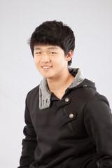 Asian man smiling at the camera