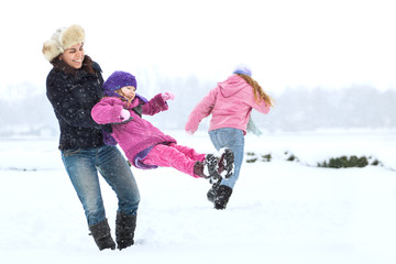 Happy family enjoying in winter