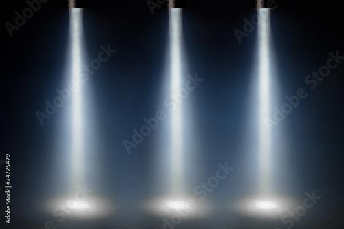 Foto op Plexiglas Licht, schaduw three blue spot lights on stage