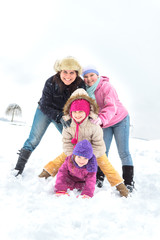 Happy family enjoying in winter