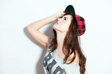 Closeup fashion studio portrait of hipster young girl