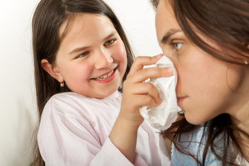 Mother and daughter with cold or flu