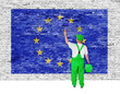 Painter covers brick wall with flag of European Union