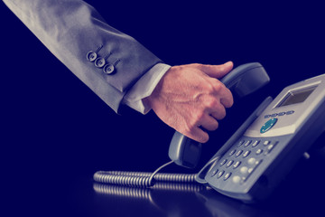 Retro image of businessman making a phone call