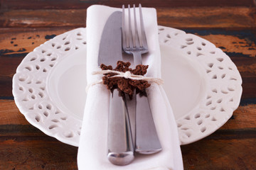 Christmas decoration: White plate serviette fork knife with hand