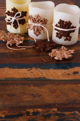 Christmas decoration of candle with handmade brown crochet snowf