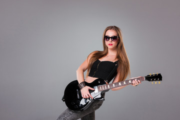 Beautiful girl playing guitar
