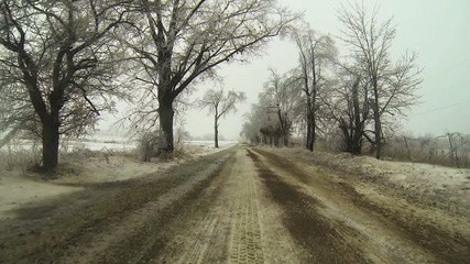 A Point of View (POV) drive through an ice storm in winter