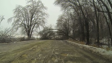 Point of View (POV) drive through an ice storm in winter