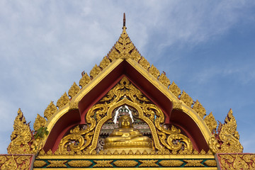 the gold Katyayana on the temple arch