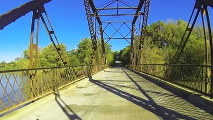 Traveling through an old iron bridge.