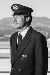 Italy, Sardinia, Olbia Airport, male flight assistant portrait