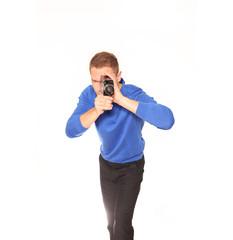 Mann filmt mit Filmkamera