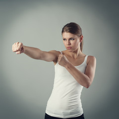 Angry female fighting. Concept of strength, aim and success