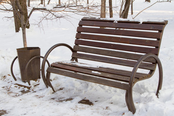bench with an urn in a park