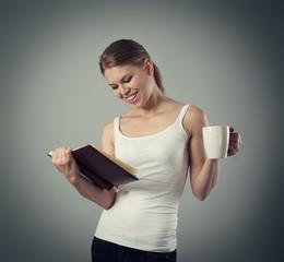 Joyful woman having evening tea. Read time, lifestyle, leisure