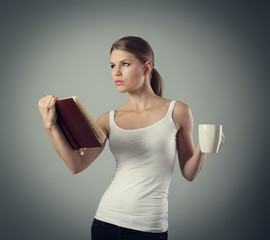 Concentrated woman with notebook thinking of her daily schedule