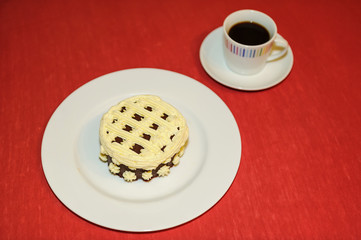cup of coffee with creamy dessert