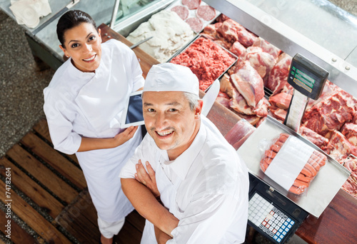 Happy Butchers Standing At Butchery Counter - 74782614