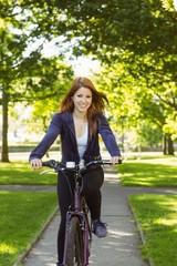 Pretty redhead cycling a bike