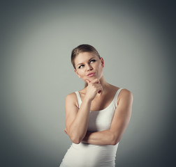 Studio portrait of young pensive woman having doubts
