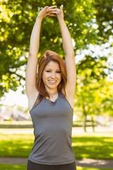Portrait of a pretty redhead stretching