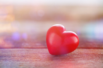 red heart on wooden board