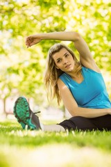 Fit blonde stretching in the park