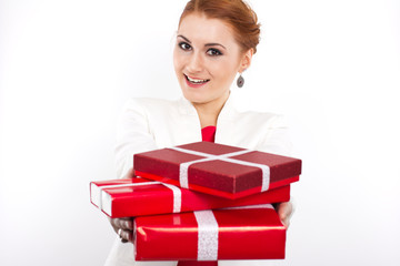 Young girl in red dress with gift red box