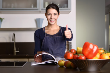 Happy Woman in the Kitchen giving thumbs up