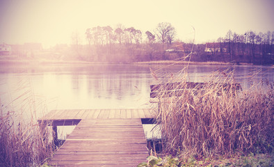 Vintage retro toned image of lake in autumn.