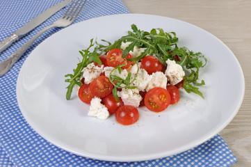 salad arugula with cherry tomatoes and mozzarella