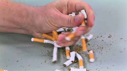 cigarettes destroyed fist