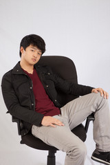 Asian man looking thoughtful