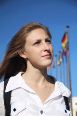 girl student on the background of international flags