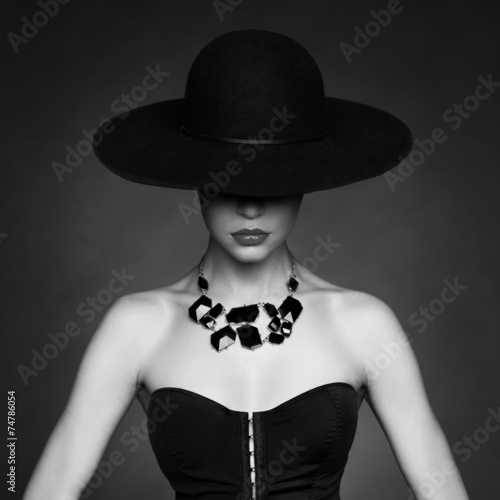 Elegant lady in hat - 74786054