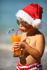 funny santa with a cocktail on the beach