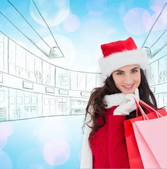 Cheerful brunette in winter wear holding shopping bags