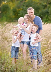 portrait of happy family relaxing in nature summer