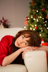 Beautiful redhead relaxing on the couch at christmas