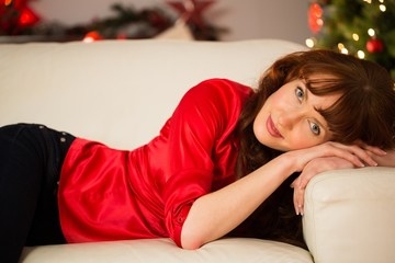 Portrait of a pretty redhead relaxing at christmas