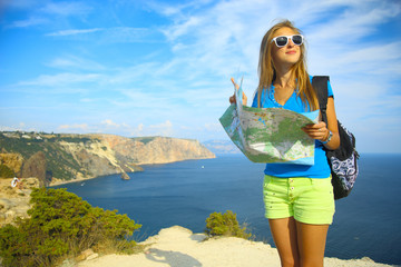 beautiful girl traveling on mountain coast