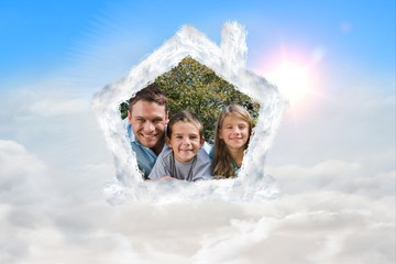 Composite image of happy family lying on the grass