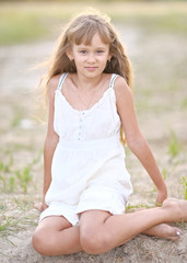 portrait of a little girl in summer nature