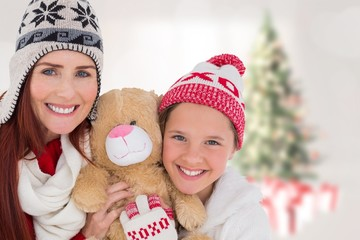 Composite image of mother and daughter with teddy