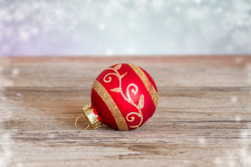 red christmas ball on wooden background