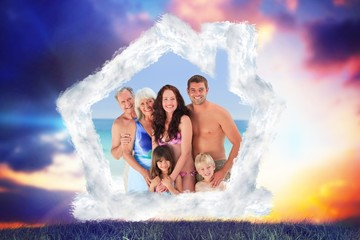 Composite image of portrait of a joyful family at the beach