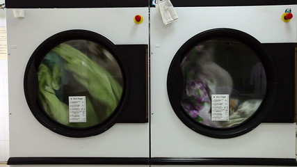 View of automatic washing machines in laundry