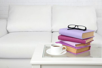Purple books with cup and glasses